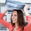 Playful young business clerk with folders — Stock Photo