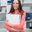 Businesswoman holding a large file — Stock Photo