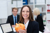 Successful businesswoman with a piggy bank — Stock Photo