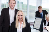 Coworkers in a busy corporate office — Stock Photo