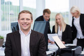 Smiling successful young businessman — Stock Photo