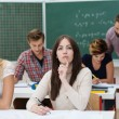 Young female students studying in the classroom — Stock Photo