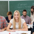 Beautiful happy young woman in class — Stock Photo