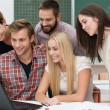 Successful team of young students — Stock Photo