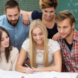 Teamwork amongst students — Stock Photo