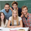 Group of young male and female students — Stockfoto