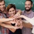 Teamwork and collaboration amongst students — Stock Photo