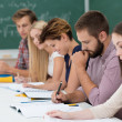 Group of students at work in the classroom — Stock Photo