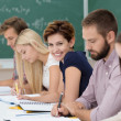 Smiling young woman in the classroom — Stock Photo