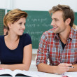 Attractive young male and female students — Stock Photo