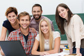 Friendly smiling group of students — Stock Photo