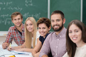 Group of happy successful university students — Stock Photo