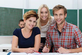 Smiling university students — Stock Photo
