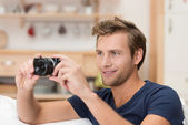 Handsome man taking a photograph — Stock Photo