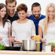 Group of beautiful young women cooking — Stock Photo