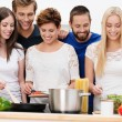 Stock Photo: Group of beautiful young women cooking