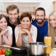 Young people in the kitchen preparing pasta — Stock Photo