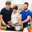 Stock Photo: Group of friends preparing dinner