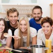 Smiling multicultural group of friends cooking — Stock Photo