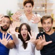 Excited group of young men and women — Stock Photo
