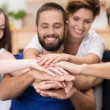 Stock Photo: Friends stacking hands