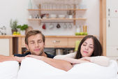 Young couple relaxing with closed eyes — Stock Photo