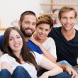 Young friends relaxing at home — Stock Photo