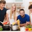 Group of young friends preparing pasta — Stock Photo