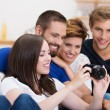 Group of friends checking out a photo — Stock Photo