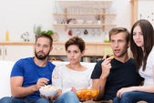 Group of friends watching a gripping movie — Foto Stock