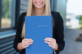 Woman holding her curriculum vitae — Stock Photo