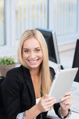 Happy businesswoman with a tablet-pc — Stock Photo