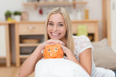 Beautiful woman with a piggy bank — Stock Photo