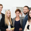 Smiling confident group of business people — Stock Photo