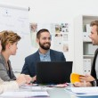 Smiling manager with his business team — Stock Photo