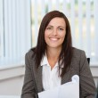 Successful businesswoman working at her desk — Stock Photo