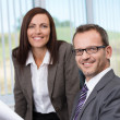 Smiling boss with his secretary — Stock Photo