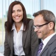 Smiling secretary with her boss — Stock Photo #33040175