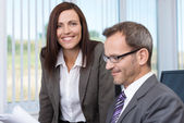 Smiling secretary with her boss — Stock Photo