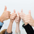 Business team giving a victorious thumbs up — Stok fotoğraf