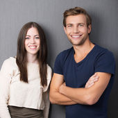 Happy confident young couple — Stock Photo