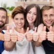 Happy smiling friends giving a thumbs up — Stock Photo