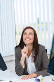 Happy businesswoman in the office — Stock Photo