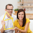 Stock Photo: Motivated young couple planning for home
