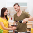 Man pouring his wife a glass of wine — Stock Photo #34572141