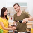 Stock Photo: Man pouring his wife a glass of wine