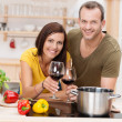 Cheerful young couple cooking a meal — Stock Photo