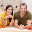 Happily married couple preparing a meal — Stock Photo