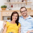 Affectionate couple relaxing on a sofa — Stock Photo #34573539