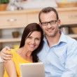 Young couple with a tablet — Stock Photo